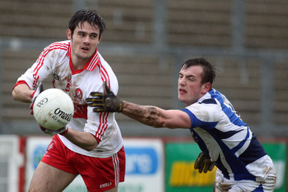 Derry's Chrissy McKaigue and Laois' Gary Walsh. INPHO