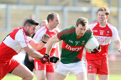 Mayo&#39;s Colm Boyle and Derry&#39;s Mark Craig<br />&#169;INPHO