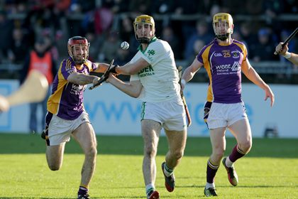 Kilmacud Crokes&#39; Damien Kelly with Colin Fennelly of Ballyhale Shamrocks<br />&#169;INPHO