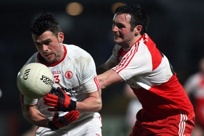 Tyrone&#39;s Darren McCurry and Derry&#39;s Oisin Duffy<br />&#169;INPHO