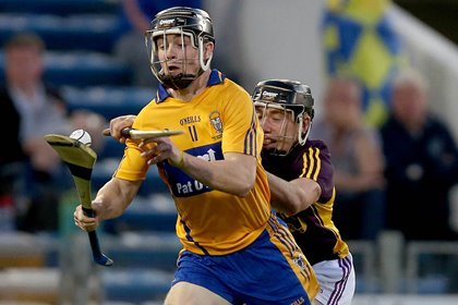 Tony Kelly of Clare with Eoin Conroy of Wexford<br />&#169;INPHO