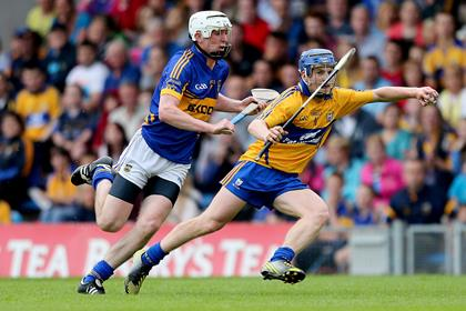 Tipperary&#39;s Seamus Kennedy and Podge Collins of Clare<br />&#169;INPHO/James Crombie