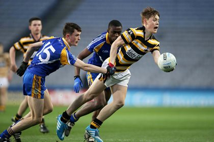 Colaiste Eoin&#39;s Conn O&#39;Ceallachain is tackled by Brian Stack and Sam Omukoro of Marist College<br />&#169;INPHO/Cathal Noonan