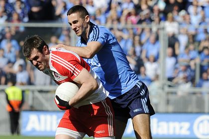 Derry&#39;s Mark Lynch with James McCarthy of Dublin<br />&#169;INPHO
