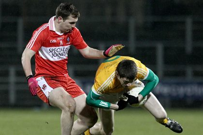 Antrim&#39;s John Carron and Derry&#39;s Ryan Bell.<br />&#169;INPHO.