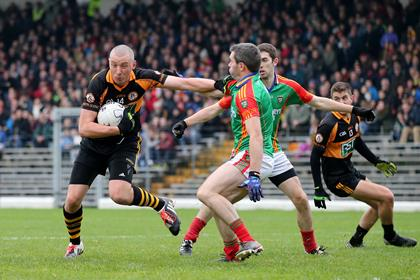 Austin Stacks&#39; Kieran Donaghy and Fergal Griffin of Mid Kerry<br />&#169;INPHO