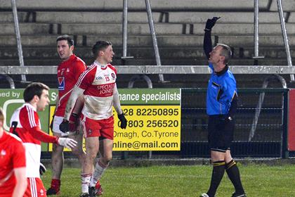 Derry&#39;s Declan Mullan becomes the first player to be shown the black card by referee Brendan Rice.<br />&#169;INPHO/Presseye/Russell Pritchard