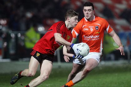 Armagh&#39;s Peter Carragher with Down&#39;s Jerome Johnston.<br />&#169;INPHO/Presseye/Jonathan Porter.