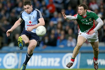 Dublin's Paddy Andrews and Keith Higgins of Mayo ©INPHO/Ryan Byrne