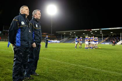 Tipperary manager Eamon O&#39;Shea and assistant manager Michael Ryan stand for the national anthem before the game at Semple Stadium.<br />&#169;INPHO/Cathal Noonan.