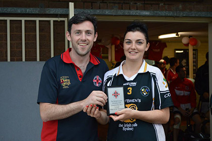 Cusacks Chairman, Kieran Olwell with Central Coast Camogie Captain, Ciara Storey.