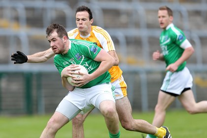 Fermanagh&#39;s Sean Quigley with Antrim&#39;s Ricky Johnston<br />&#169;INPHO