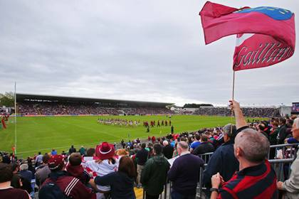 The Galway and Mayo teams parade behind the band at Pearse Stadium ©INPHO/Cathal Noonan