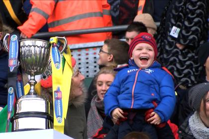 A happy young fan spots himself on the big screen at the AIB All-Ireland Club Camogie finals ©Jerome Quinn Media