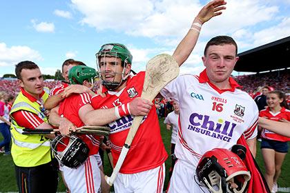 Cork's Alan Cadogan and Darren McCarthy celebrate after the 2014 Munster SHC final win. INPHO