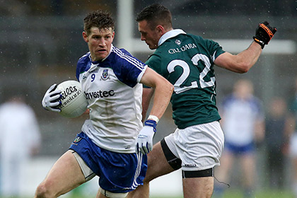 Kildare's Eoin Doyle and Darren Hughes of Monaghan. INPHO