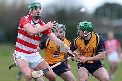 DCU's Cathal Curran and Aidan Walsh of CIT during the Fitzgibbon Cup Round 1 game at DCU Sportsgrounds. INPHO