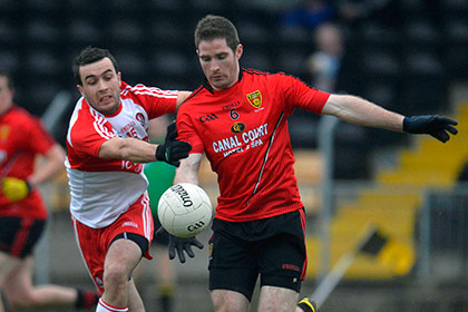 Derry's Aaron Kerrigan and Down's Aidan Carr during the O'Fiach Cup game at Crossmaglen. INPHO
