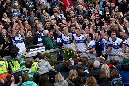 St Vincents captain Ger Brennan lifts the All Ireland Club SFC Cup at Croke Park while his team mates celebrate. INPHO