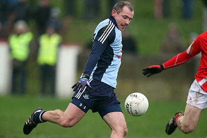 Pat Burke in action for Dublin. INPHO