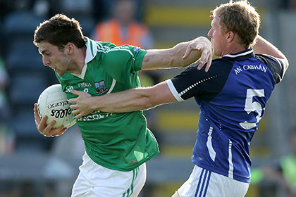 Eoin Donnelly of Fermanagh with Cavan's James McEnroe. INPHO