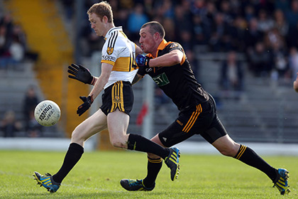 Colm Cooper of Crokes with  Kieran Donaghy of Austin Stacks. INPHO