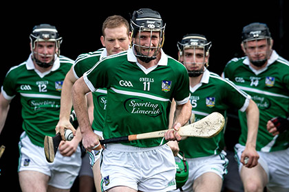 Limerick's captain Donal O'Grady leads out his team.