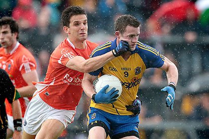 Roscommon's Kevin Higgins with Stephen Harold of Armagh. INPHO