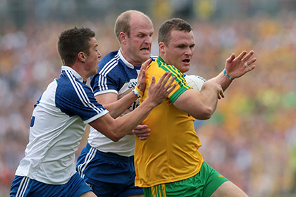 Monaghan's Ryan Wylie and Dick Clerkin with Neil McGee of Donegal during the Ulster SFC final. INPHO