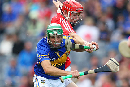 Cork's Bill Cooper and James Woodlock of Tipperary during the All Ireland SHC semi final at Croke Park. INPHO