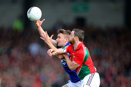 Kerry's James O'Donoghue and Keith Higgins of Mayo. INPHO