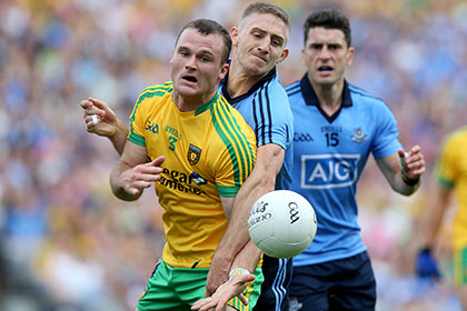 Dublin's Eoghan O'Gara with Neil McGee of Donegal. INPHO