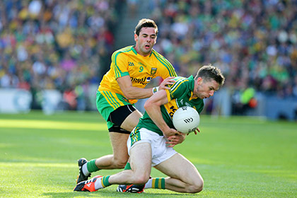 Donegal's Odhran Mac Niallais with Marc O'Se of Kerry. INPHO