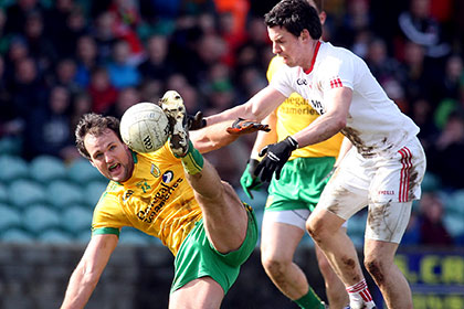 Donegal's Michael Murphy and Tyrone's Mattie Donnelly. INPHO
