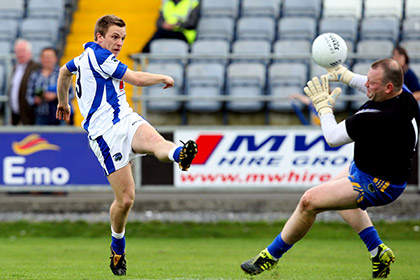 Laois' Ross Munnelly has his shot saved by goalkeeper Paul Fitzgerald of Tipperary. INPHO