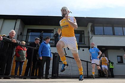 Neil McManus leads out Antrim. INPHO