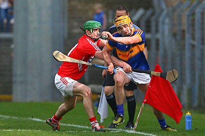 Tipperary's Ronan Maher is tackled by Cork's Seamus Harnedy. INPHO