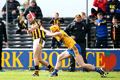 Kilkenny's Cillian Buckley scores the winning point despite the efforts of Clare's Cian Dillon. INPHO
