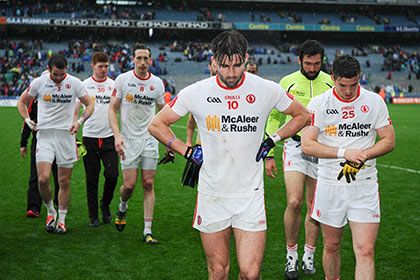 Tyrone's Tiernan McCann and Ronan O'Neill walk off the field dejected after the game. INPHO