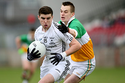 Conor McAliskey of Clonoe and Ronan Mullan of Carrickmore during the Tyrone SFC final at Healy Park. INPHO