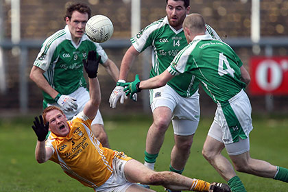 Ballinagh's Padraic O'Reilly is challenged by Rosslea's James Sherry Seamie Quigley and Conor Quigley during the Ulster Club SFC game at Brewster Park. INPHO