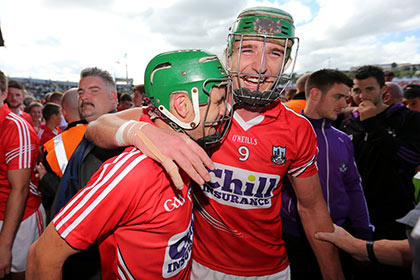 Cork's Alan Cadogan and Aidan Walsh celebrate their Munster SHC final win over Limerick. INPHO