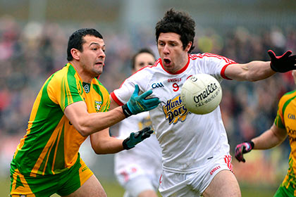 Tyrone's Sean Cavannagh and Donegal's Frank McGlynn. INPHO