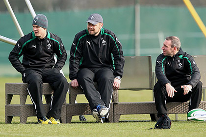 Ireland's Jonathan Sexton watches training alongside scrum coach Greg Feek and performance psychologist Enda McNulty. INPHO