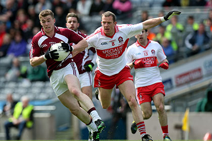 Derry's Pasty Bradley and Ger Egan of Westmeath during the NFL Division 2 final at Croke Park. INPHO