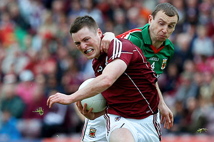 Galway's Danny Cummins and Keith Higgins of Mayo. INPHO