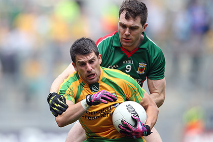 Paddy McGrath of Donegal with Mayo's Seamus O'Shea. INPHO