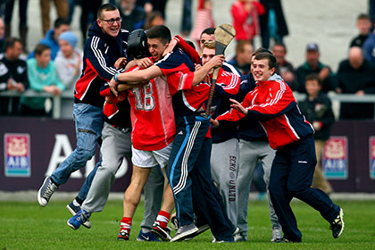Sean Hogan of Passage is mobbed by supporters at the final whistle. INPHO