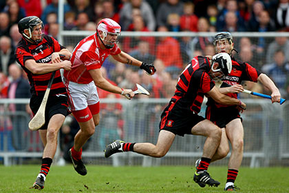 Eoin Kelly of Passage is fouled by Barry Coughlin of Ballygunner during the Waterford SHC final at Walsh Park. INPHO