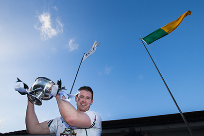 Kildare captain Eoghan O'Flaherty lifts the O'Byrne Cup. INPHO